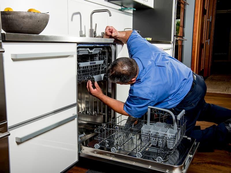 handyman repairing dishwasher